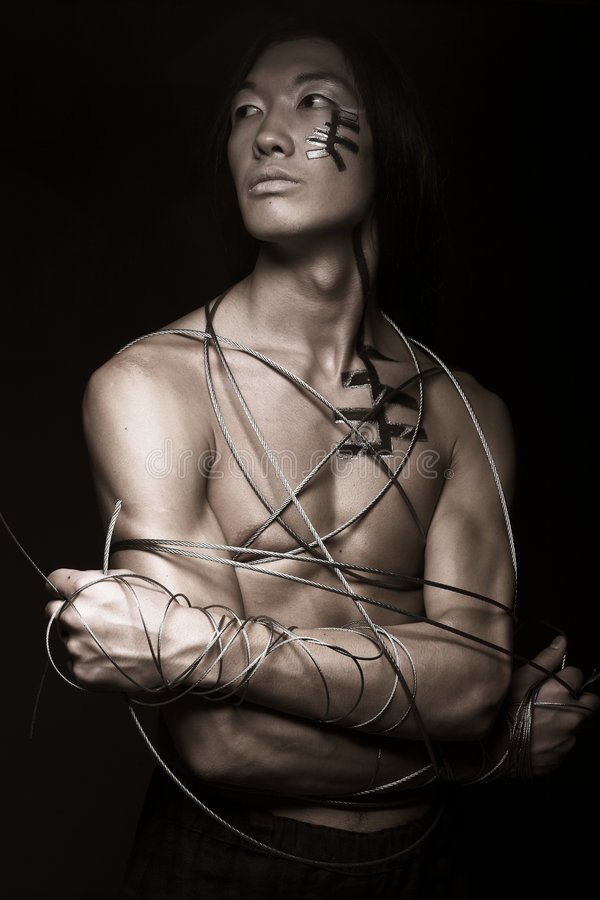 Man with steel wire. Isolated on black background stock images