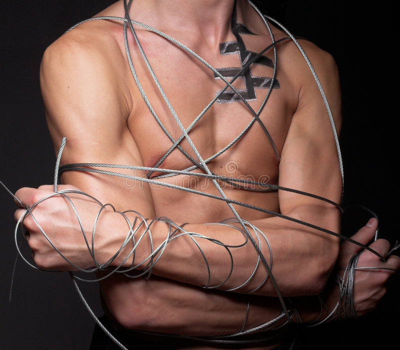 Man with steel wire. Studio portrait of a man with steel wire stock image