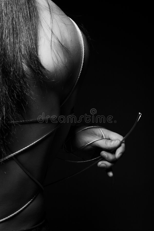 Man with steel wire. Close-up black-and-white photo of a man with steel wire stock photos