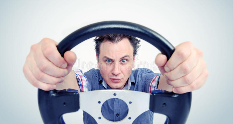 Man with a steering wheel, front view. Driver car concept.  royalty free stock photography