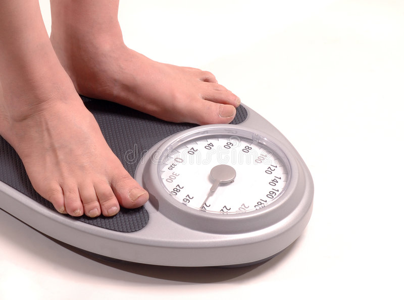 Man stepping on a scale royalty free stock photo