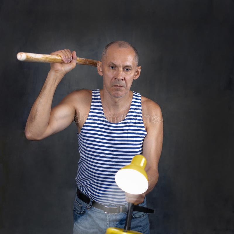A man with a stick. stock photography
