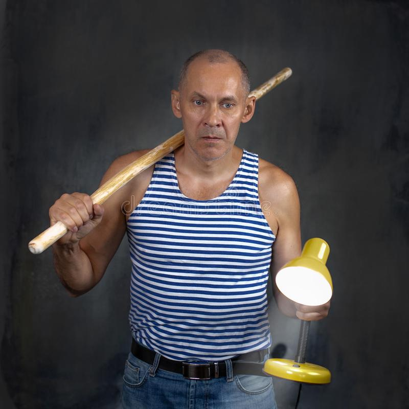 A man with a stick. royalty free stock image