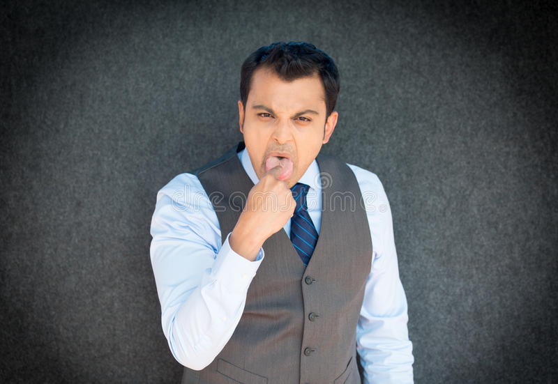 Man sticking finger in mouth royalty free stock photos