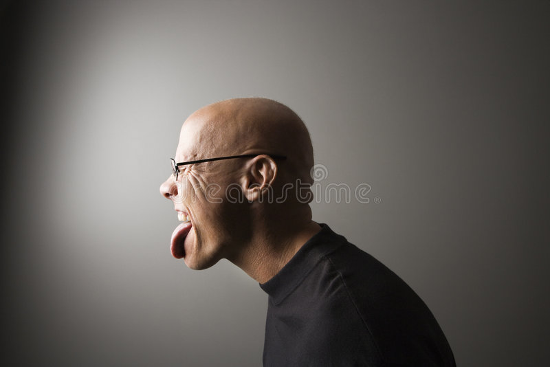 Man sticking out tongue. stock image