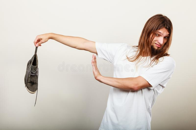 Man with stinky shoe stock image
