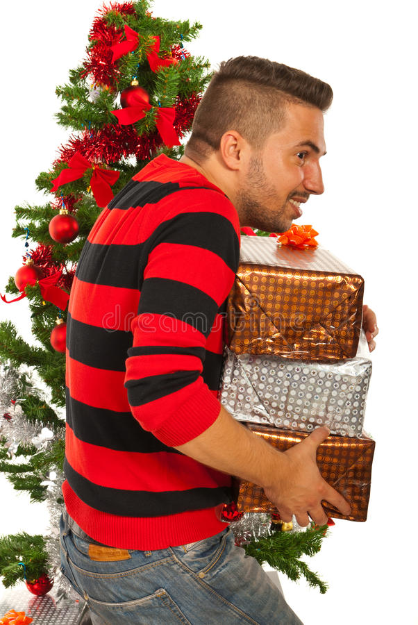 Man stole Christmas gifts. Rude man stolling Christmas presents isolated on white background royalty free stock photos