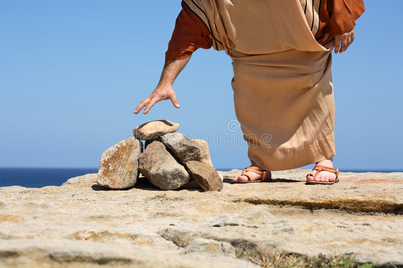 Man by stones concept Sin Punishment stock images