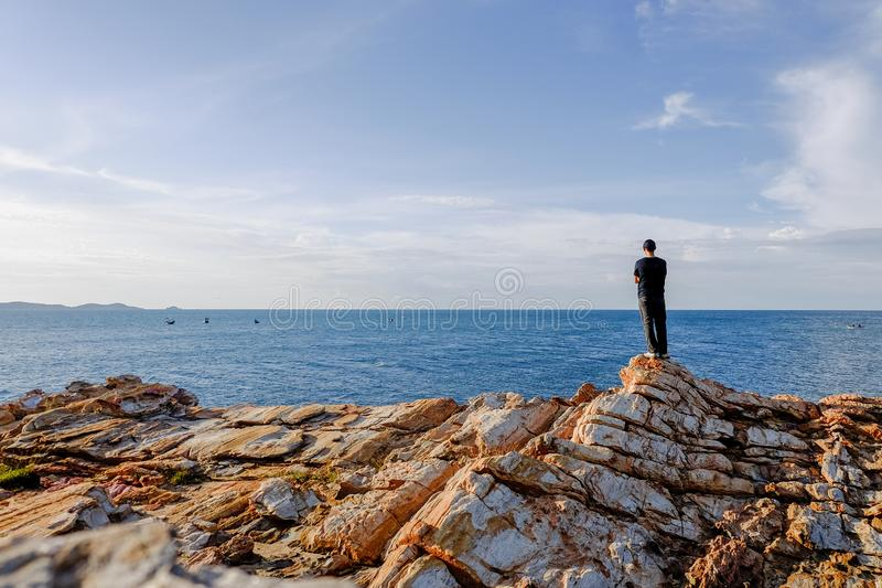Man stood and folded his arms and stood. Watching the view at Khao Laem Ya, Rayong, Thailand stock image