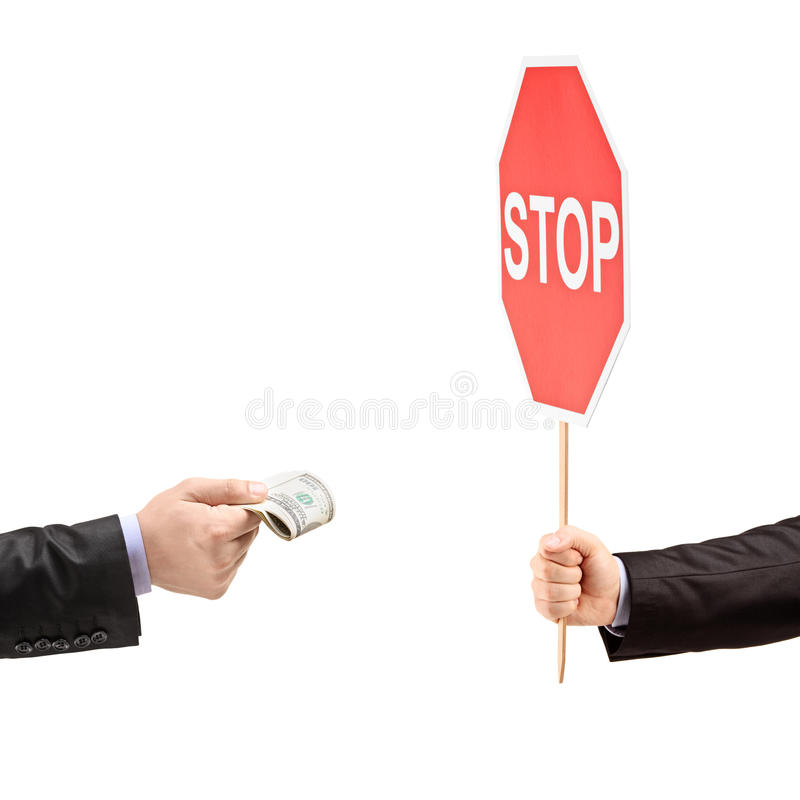 Man with a stop sign saying no to bribery. Isolated on white background royalty free stock images