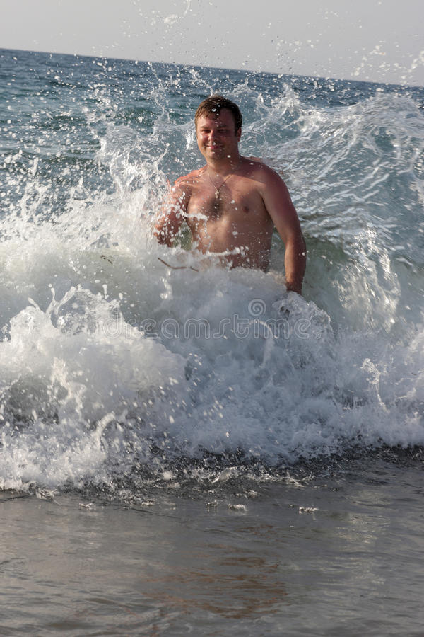Man In Stormy Sea Stock Images