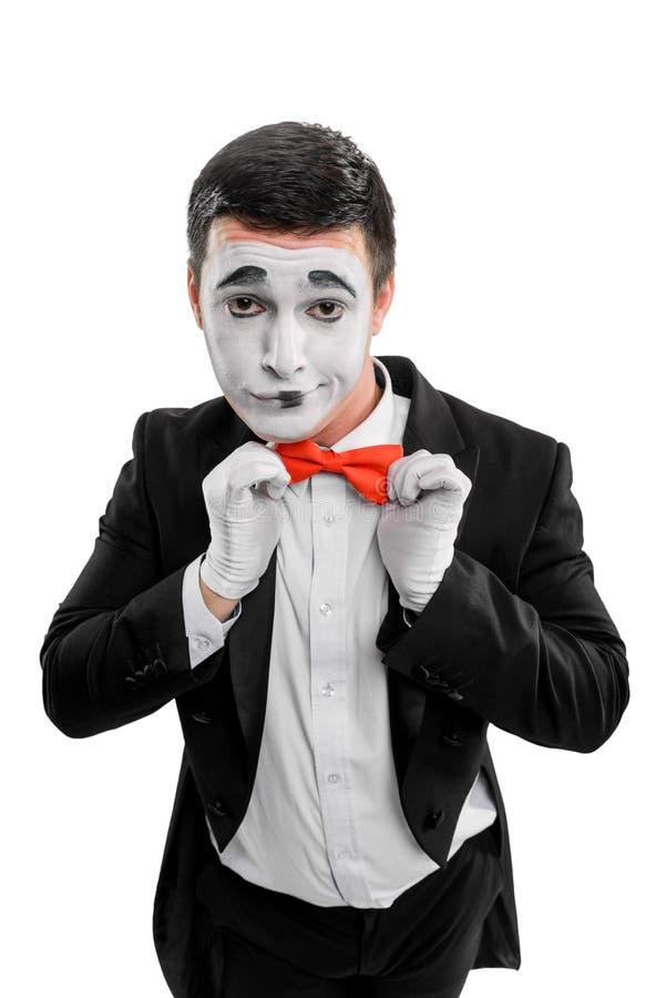 Man straightening red bow tie stock photos
