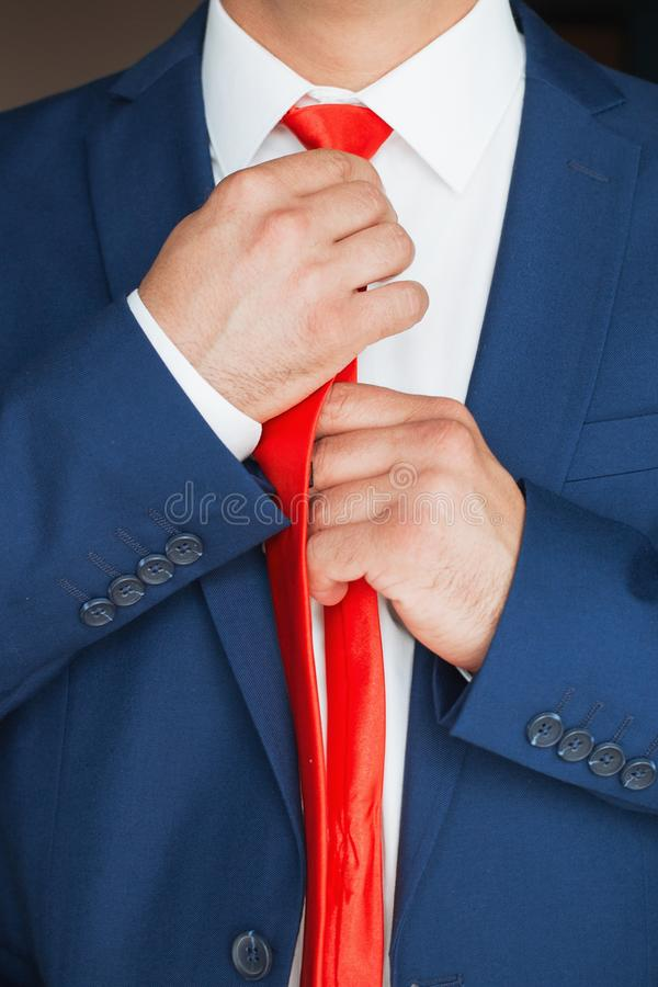 The man straightens his tie royalty free stock images