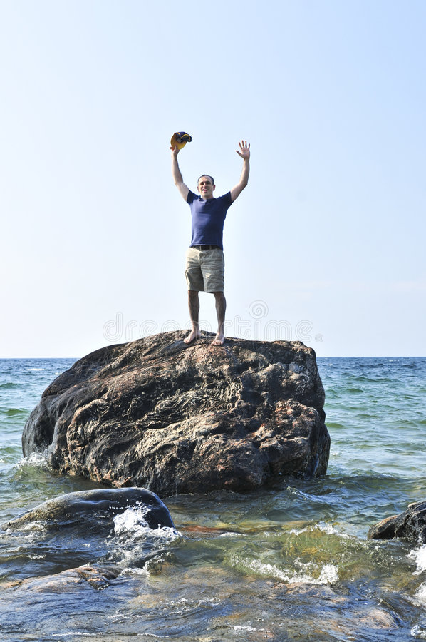 Free Man Stranded On A Rock In Ocean Stock Photo - 6218650