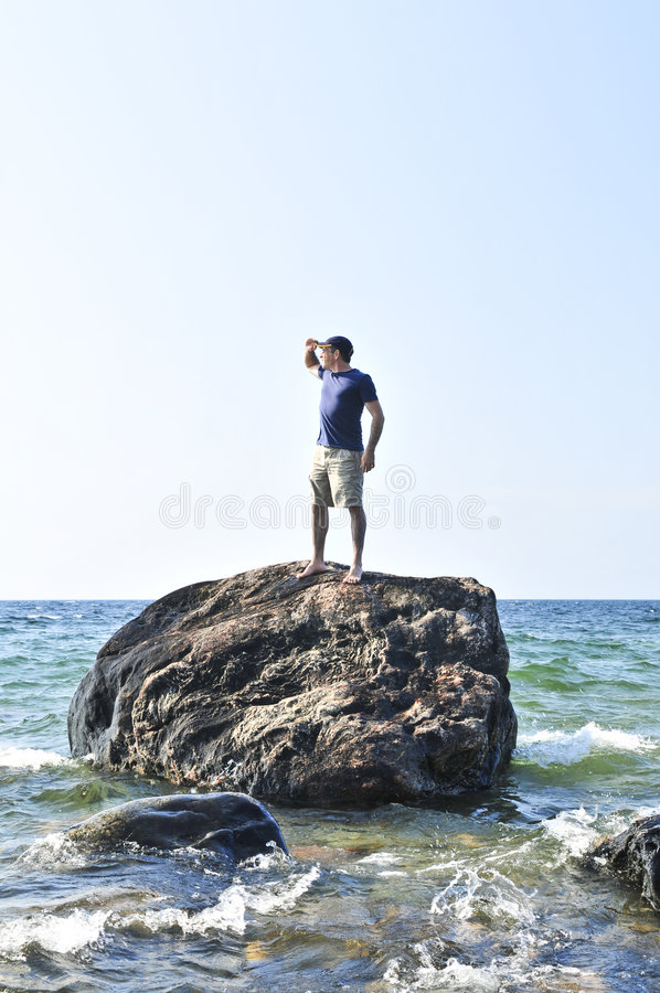 Free Man Stranded On A Rock In Ocean Royalty Free Stock Photos - 6218658