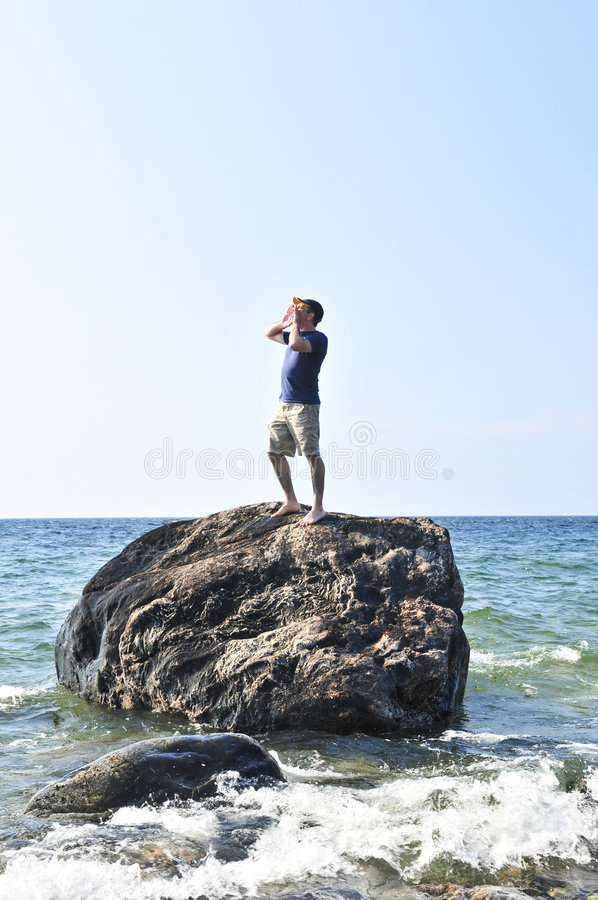 Download Man Stranded On A Rock In Ocean Stock Image - Image: 6290263