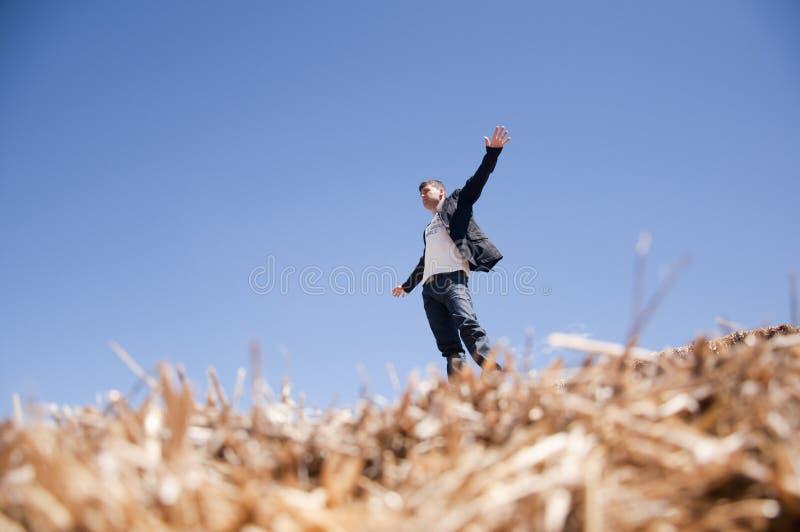 Man on straw bale