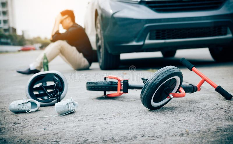 Man are stressed while being drunk with driving crash a child bike accident occurs stock images