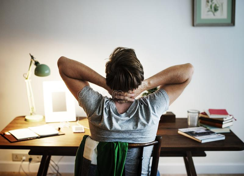 Man stressed while working on laptop stock image