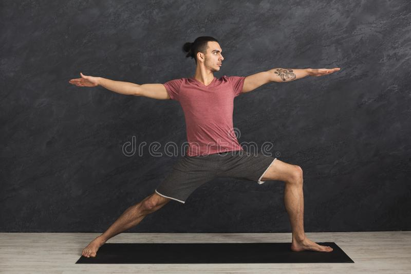 Man stretching hands and legs at gym stock photos