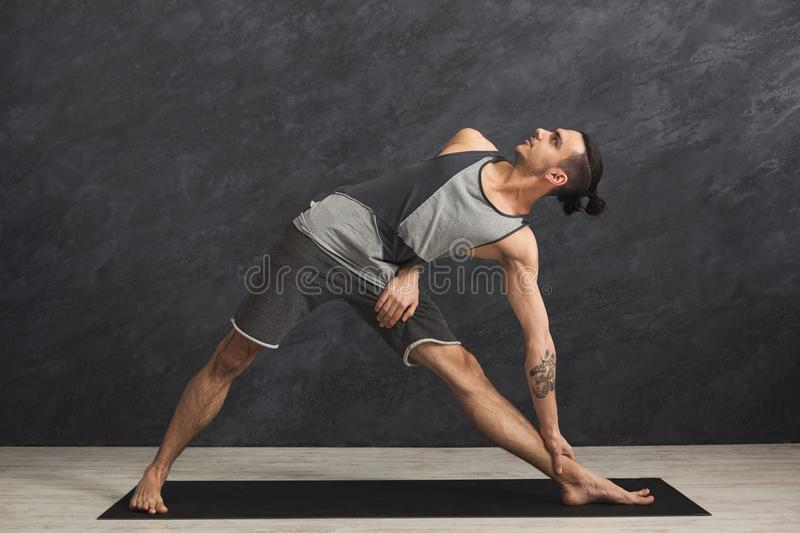 Man stretching hands and legs at gym royalty free stock image