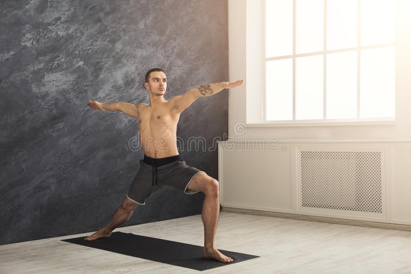 Man stretching hands and legs at gym stock photography