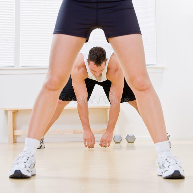 Man stretching in health club