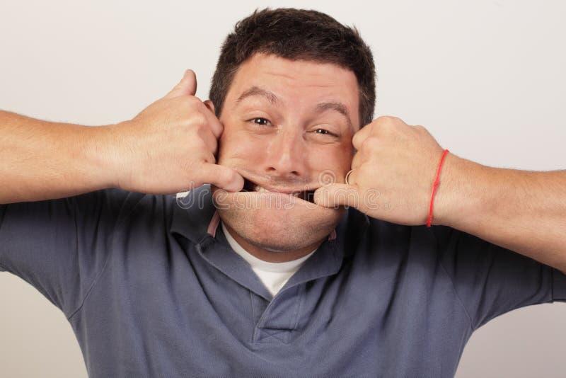 Man stretching his face stock photos