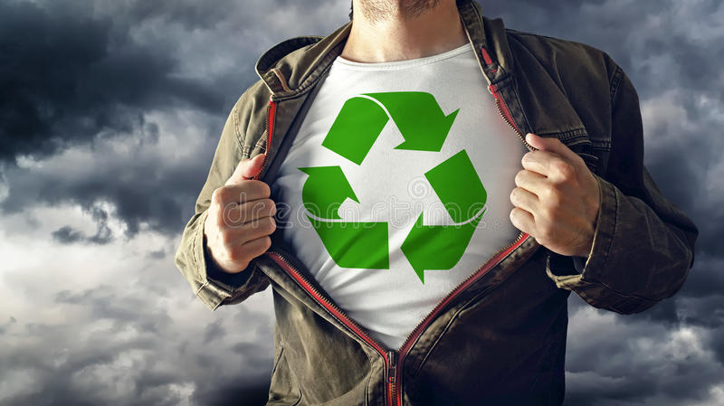 Man stretching jacket to reveal shirt with recycle symbol printed. Concept of environmental conciousness and natural preservation royalty free stock photo