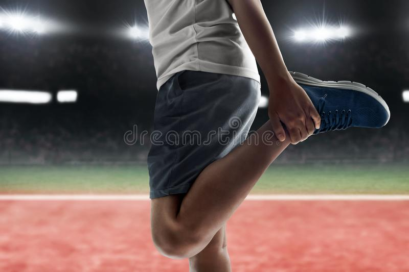 Man stretching leg before race. Man stretching leg before racing stock images
