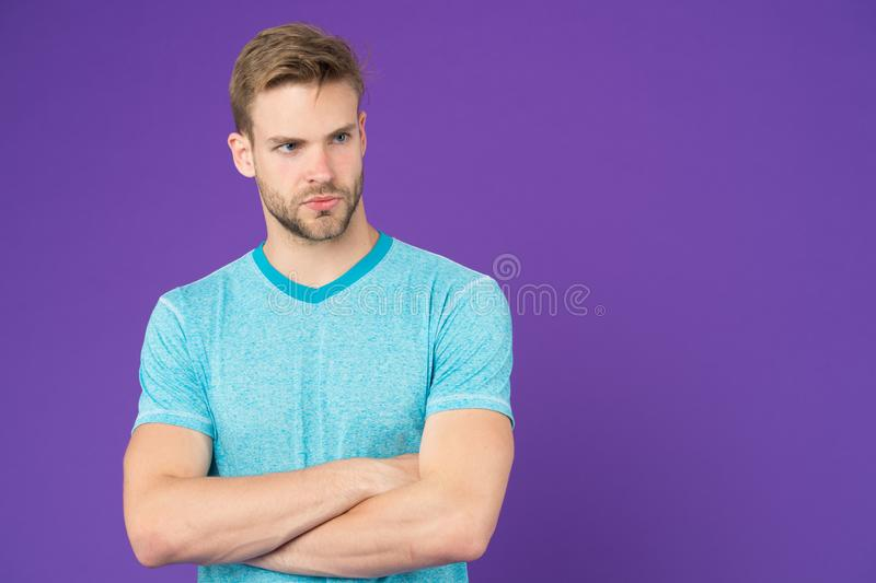 Man strict handsome unshaven guy on violet background. Masculinity concept. Man with muscular arms confident and strong. Does having muscular body make you stock image