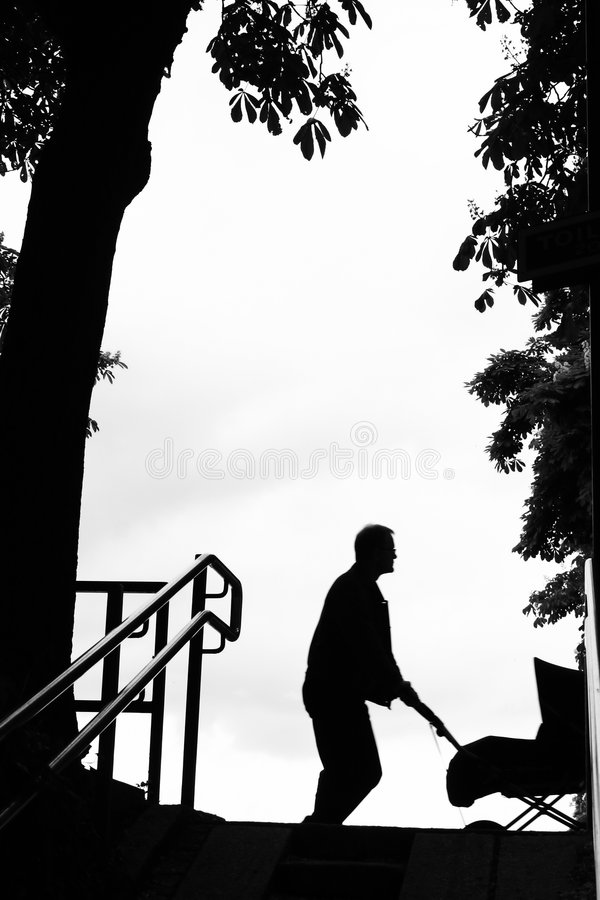 Man with stroller stock photography
