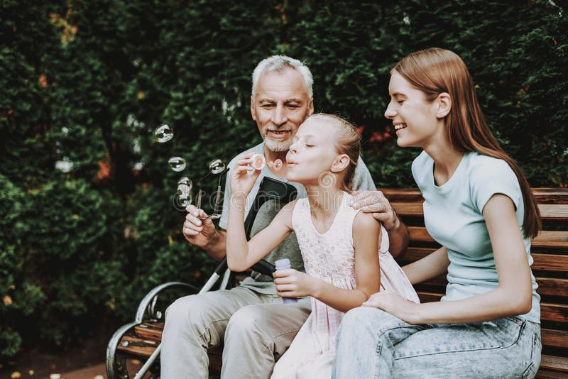 Happy Family and Young Girl. Old Man and Girl. stock photos