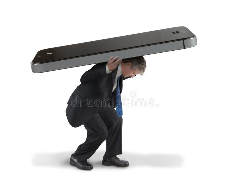 Man struggling to carry huge cell smartphone representing social media burnout and hypermedia. Man struggling to carry huge cell smartphone representing social stock photos