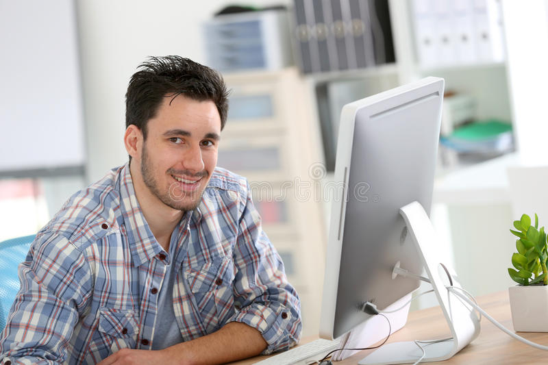 Man student in design working at office royalty free stock photography