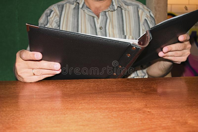 The man is studying the menu stock photography