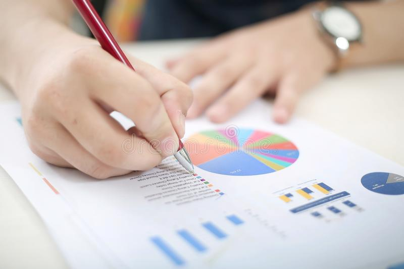 Man is studying the pie chart and bar graph stock photo