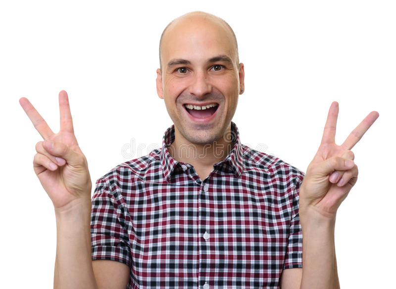 Man in stylish shirt showing victory sign. Isolated royalty free stock photo