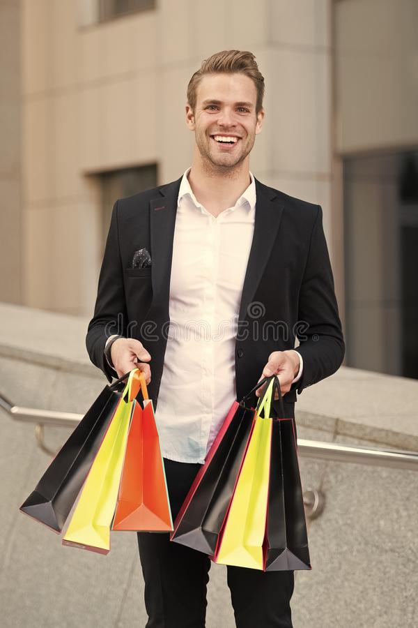 Man stylist professional shopper. Clothes courier. Stylist buy fashionable clothes client. Shopping service concept. Man. Formal suit shopping mall. Shop royalty free stock photo