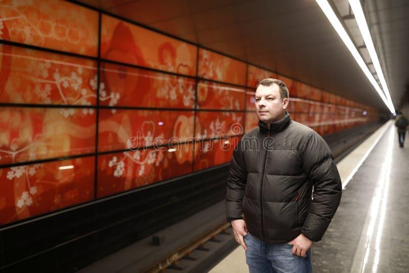 Man on subway station platform. Portrait of man on subway station platform royalty free stock images