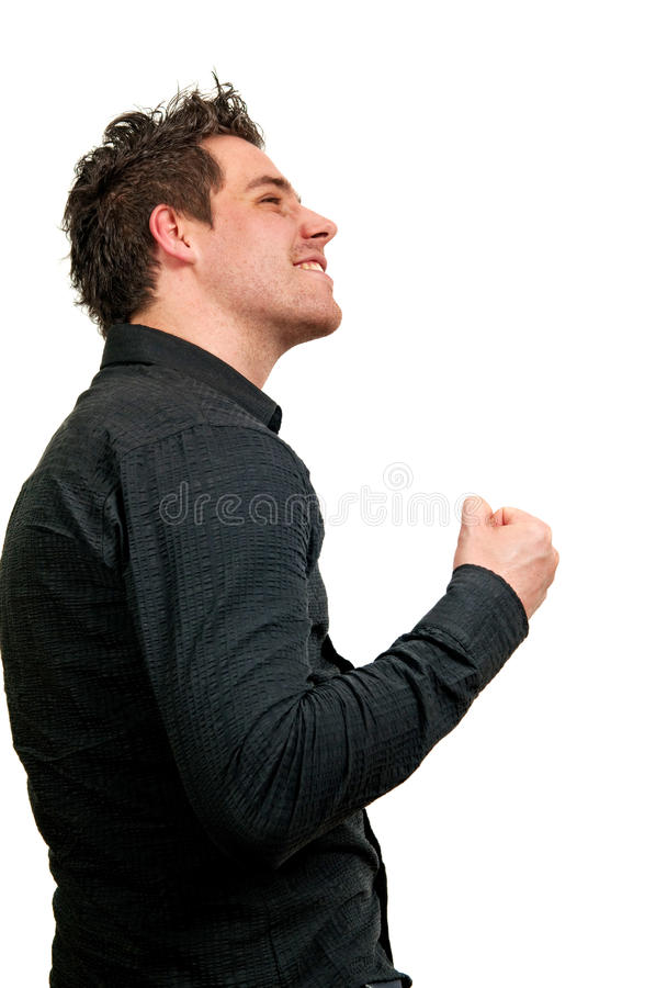 Man and success. Young handsome man happy after his success royalty free stock image