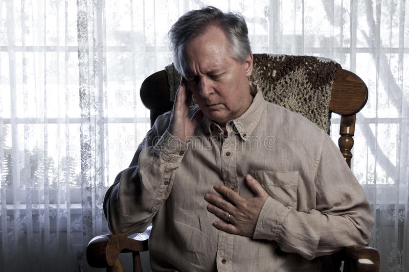 Man Suffering with Chest and Head Pains royalty free stock images