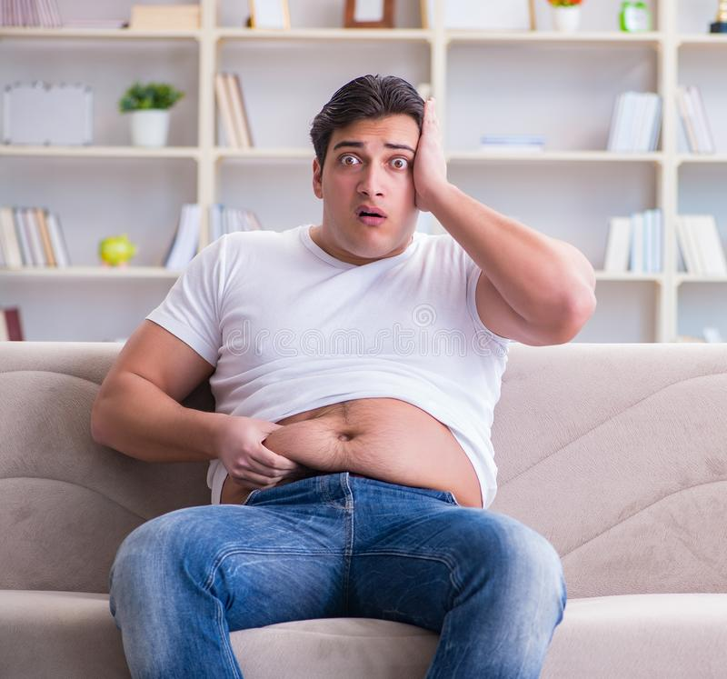 Man suffering from extra weight in diet concept royalty free stock image