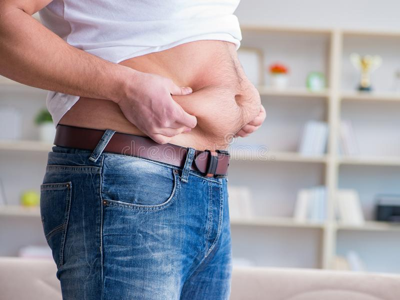 Man suffering from extra weight in diet concept royalty free stock photo