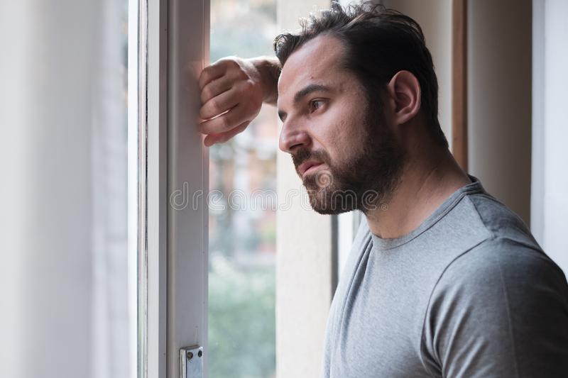 Man suffering and feeling alone at home royalty free stock photography