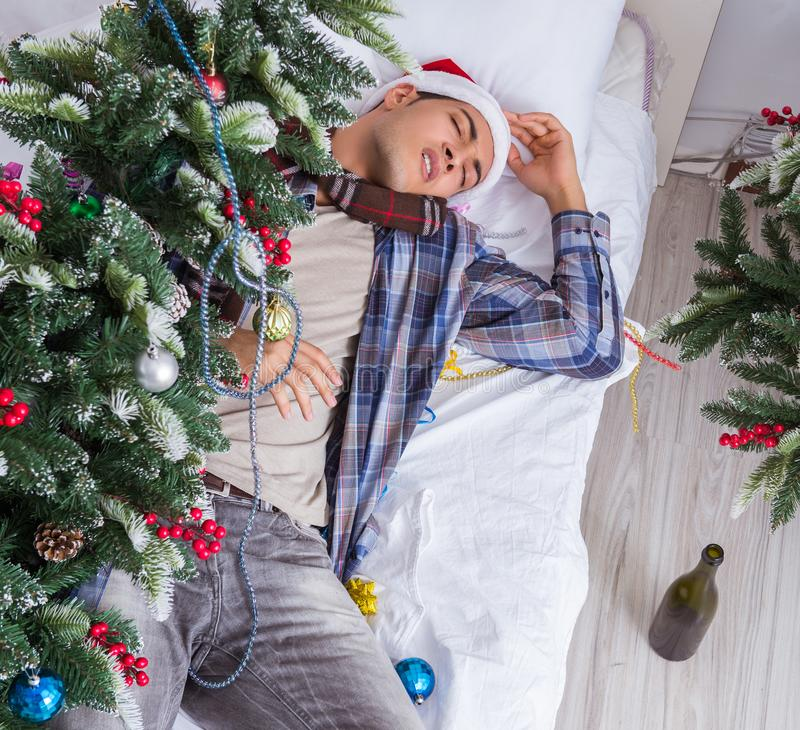 Man suffering hangover after christmas party royalty free stock photo