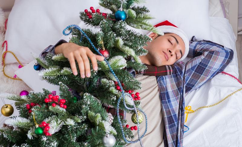 Man suffering hangover after christmas party royalty free stock images