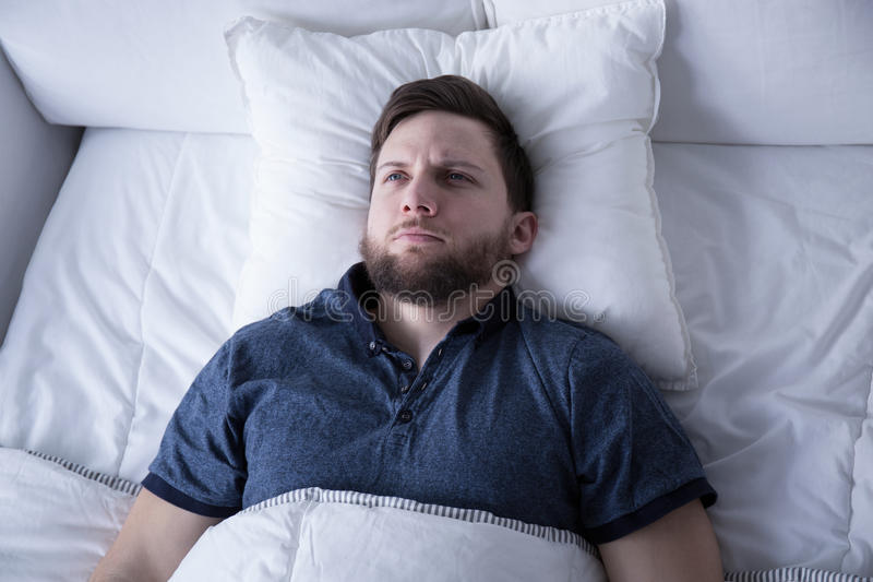 Man suffering from insomnia royalty free stock image
