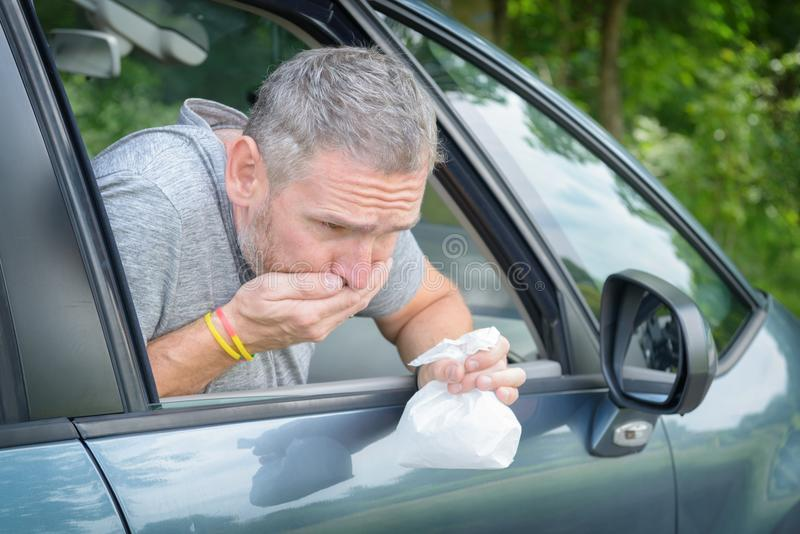 Man suffering from motion sickness royalty free stock photos