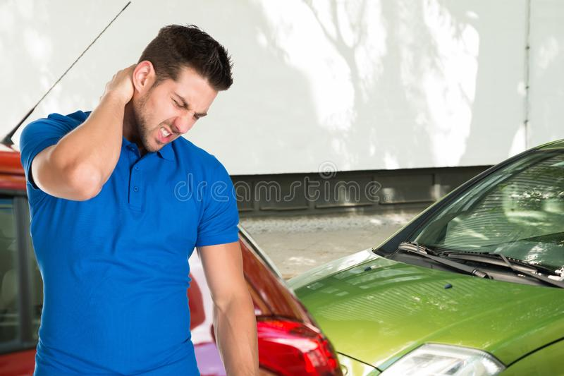 Young Man Suffering From Neck Pain stock photography